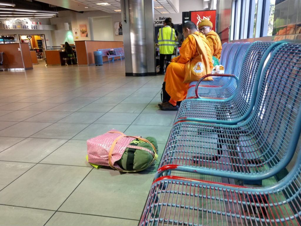 Pink carry all bag at bus depot