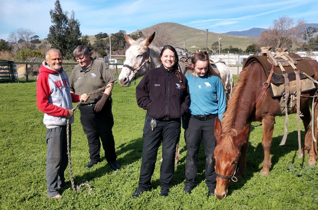 Patrick and his caring staff at San Luis Obispo County Animal Shelter with the Mules